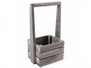 A small gray wooden box with a handle at Wasserman.eu